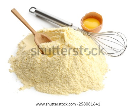 Heap of cornmeal with egg and corolla isolated on white - stock photo