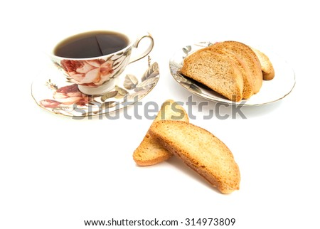 heap of crackers and cup of tea on white background - stock photo