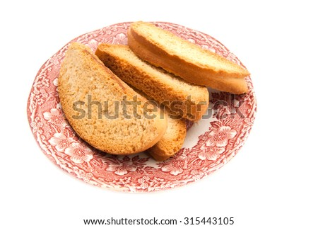 heap of crackers on a plate on white background - stock photo