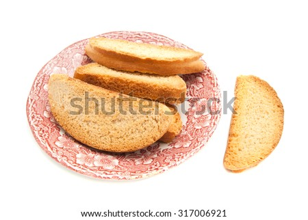 heap of crackers on glass plate on white - stock photo