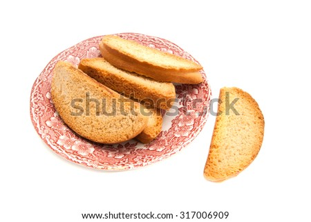 heap of crackers on glass plate on white closeup - stock photo