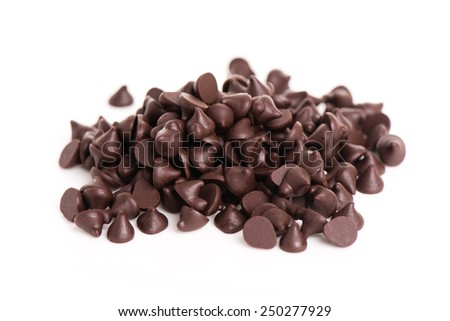 heap of dark chocolate chip on white background - stock photo