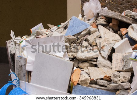 Heap of debris, construction waste and bricks from renovation house - stock photo