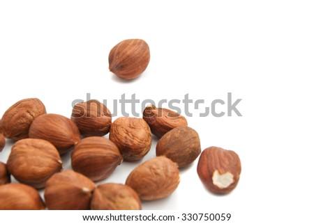 heap of delicious hazelnuts on white background closeup - stock photo