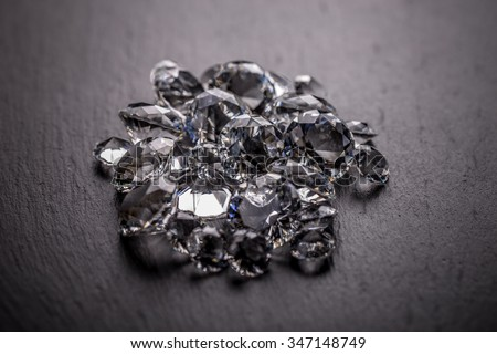 Heap of diamond on black background - stock photo