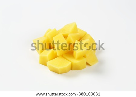 heap of diced potatoes on white background - stock photo