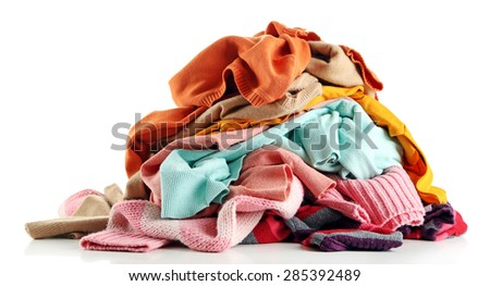 Heap of different clothes, isolated on white - stock photo