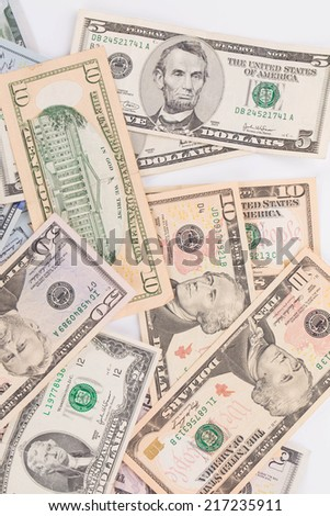 Heap of different dollar bills. Whole background. - stock photo