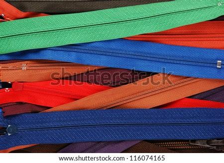 heap of different locks zipper - stock photo