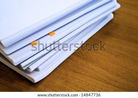 heap of documents on table - stock photo