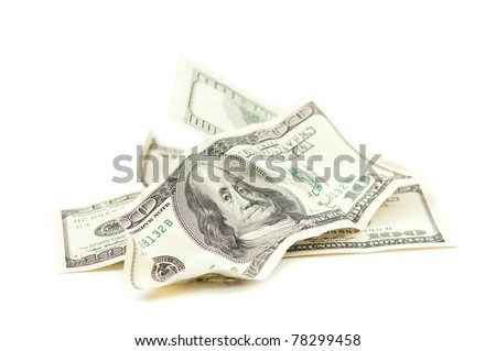 Heap of 100 dollar banknotes isolated on white background