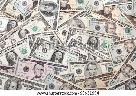Heap of dollar banknotes suitable for backgrounds