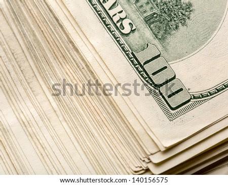 Heap of $100 dollar bills - stock photo