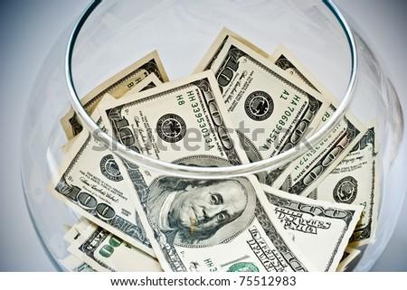heap of dollars in a bottle - stock photo