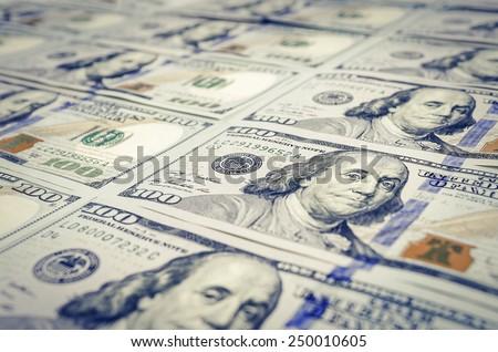 Heap of dollars, money background. Hundred dollar bills - stock photo