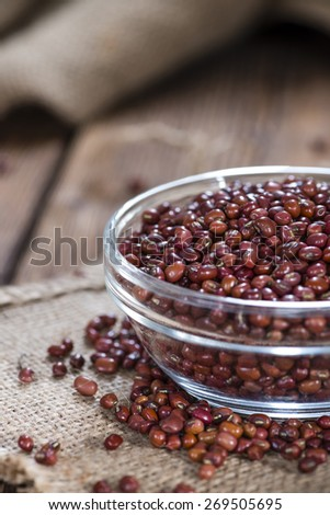 Heap of dried Red Beans (close-up shot) on wooden background - stock photo