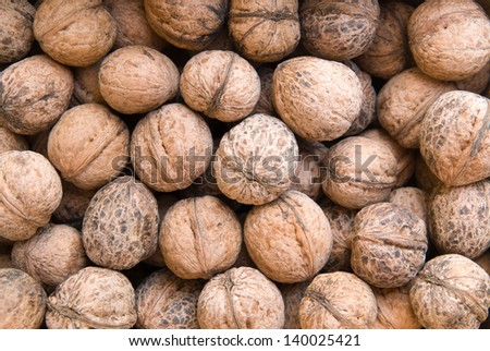 Heap of dried walnuts close-up - stock photo