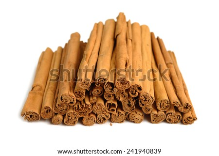 Heap of dry cinnamone isolated on white background - stock photo