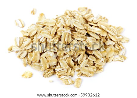 Heap of dry rolled oats isolated on white background - stock photo