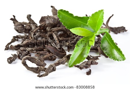 Heap of dry tea with green tea leaves isolated on a white background. - stock photo