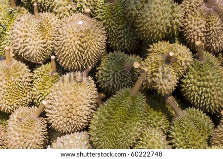 Heap of durians at a market in Asia