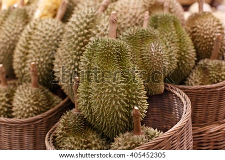 Heap of durians at a market in Thailand .