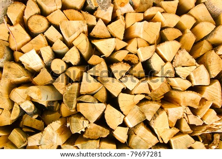 Heap of firewood - stock photo