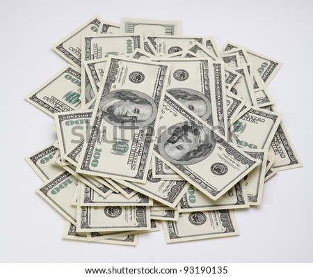 heap of five thousand dollars on the white backgrond (or hundred dollar bills money pile on the white background) - stock photo