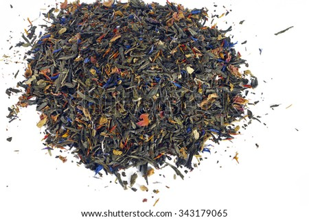 Heap of flavoured green tea without sugar or artificial sweeteners on white background. - stock photo