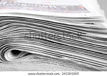Heap of folded newspapers - stock photo