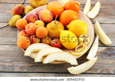 Heap of fresh fruits on wooden table close up - stock photo