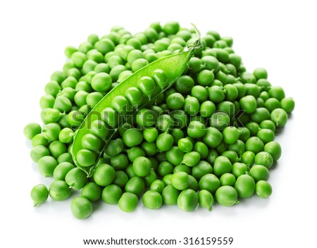 Heap of fresh green peas isolated on white - stock photo