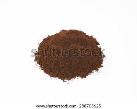heap of freshly ground coffee on white background