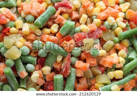 Heap of frozen vegetables. Close-up. - stock photo