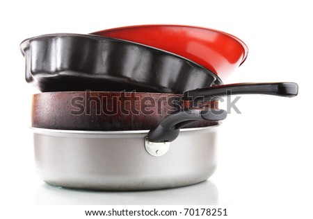 Heap of frying pans. Isolated on white background - stock photo