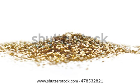 heap of golden glitters on white background