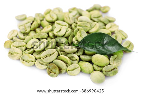 Heap of green coffee beans with leaf isolated on white - stock photo