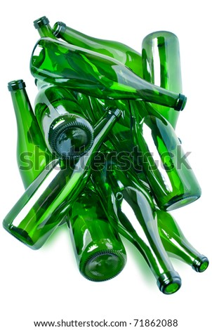 heap of green glass bottles ready for recycling isolated over white background - stock photo