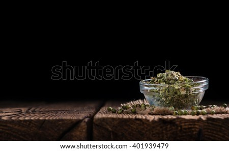 Heap of green Peppercorns (close-up shot) on vintage wooden background - stock photo
