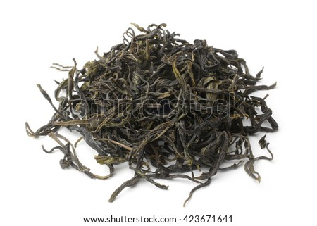 Heap of green tea on white background - stock photo