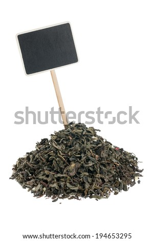 Heap of  green  tea  with a pointer for your text,  isolated on white background - stock photo