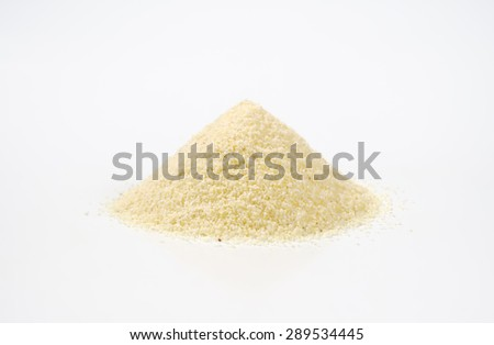 heap of grits on white background