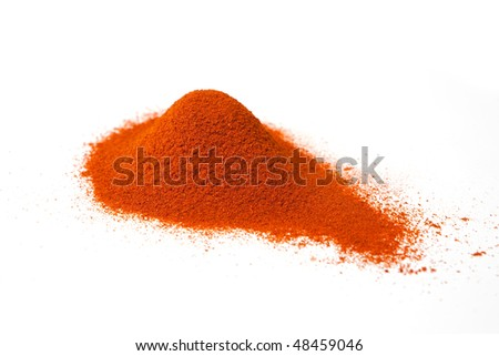 Heap of ground paprika isolated on white.
