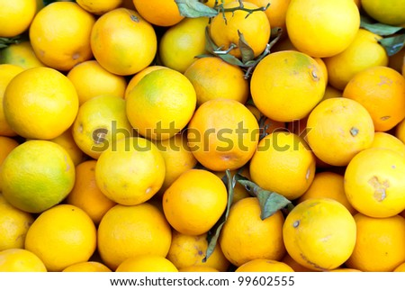 Heap of harvested oranges for sale at farmers market.