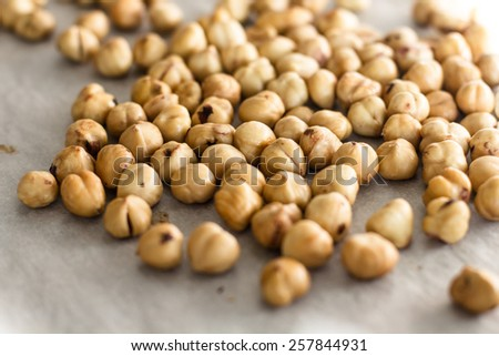 Heap of Hazelnuts fresh roasted. - stock photo