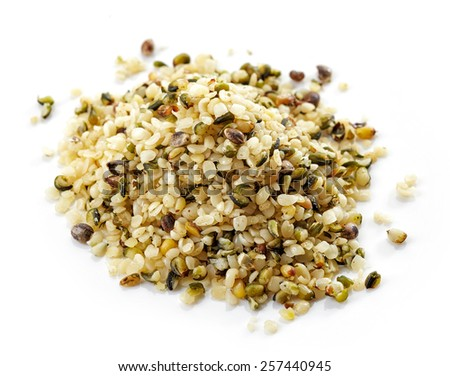 heap of hemp seeds isolated on white - stock photo