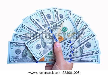 Heap of hundred dollar bills isolated on white background. - stock photo