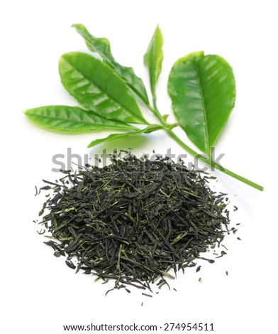 heap of japanese green tea with young leaves on white background - stock photo