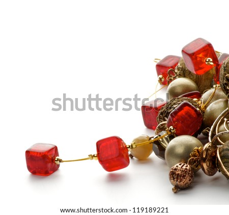 Heap of Jewelry with Gold Bracelets and Ruby Necklace closeup on white background - stock photo