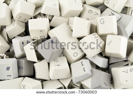 Heap of keys and buttons from old standard keyboards computer background